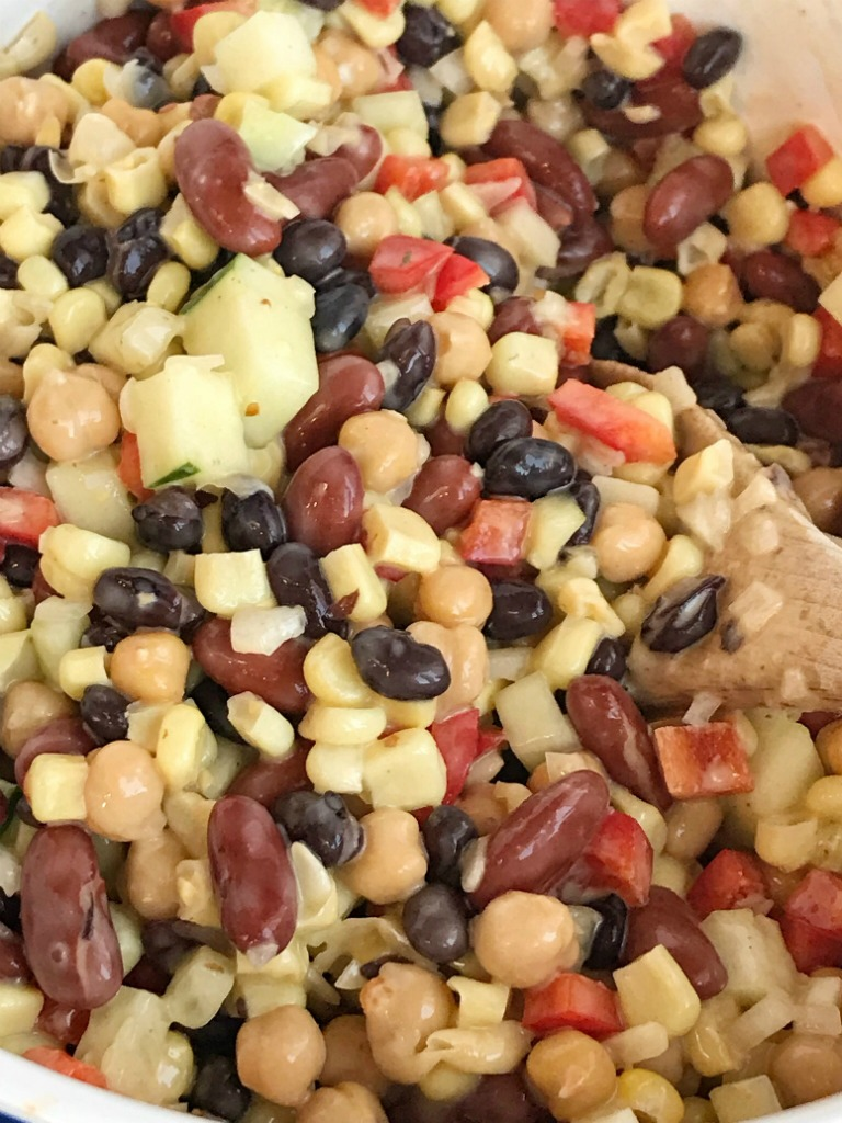 The Best Bean Salad   Salad   Side Dish   This really is the best bean salad ever! Easy, simple ingredients and fresh vegetables combine to make the tastiest, creamiest bean salad. Perfect side dish for a gathering, potluck, or BBQ. This bean salad uses convenient honey mustard salad dressing that gives it a creamy sweet flavor. #salad #sidedish #beansalad #easyrecipe