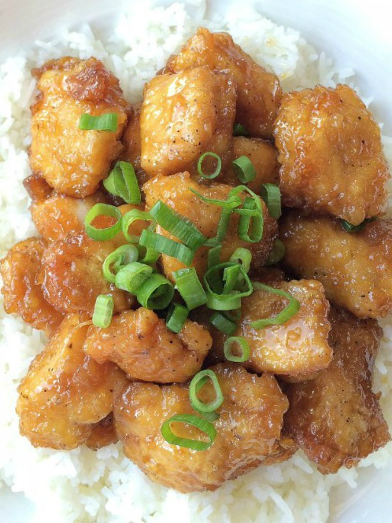 This baked orange chicken is identical to the classic Chinese orange chicken you would get as takeoutbut it's baked ! Coated in egg & cornstarch and baked in a sweet and delicious orange sauce. This is a dish that you will want to make over and over again.