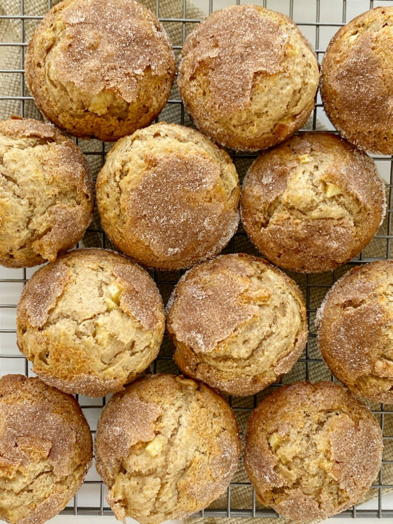 Apple Muffins with apple cider, applesauce, warm spices, and chunks of apple! They bake up so soft, perfectly rounded, and have a crunchy cinnamon & sugar topping. These are a Fall must make for my family.