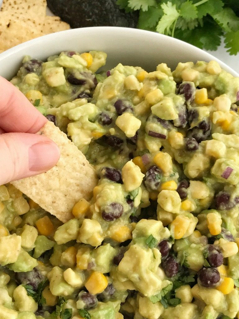 Avocado Dip   Appetizer   Dip   Dips with Avocados   Super Bowl Food   Party Food   Avocado dip is packed full with chunky avocados, corn, black beans, red onion and then drizzled with easy & convenient canned salsa verde. So much flavor with very little effort. Avocado dip is the best game day appetizer, chip dip, and party food   Together as Family #appetizerrecipes #appetizer #gamedaydips #gamedayappetizers #avocadodip #avocadodiprecipe #avocados