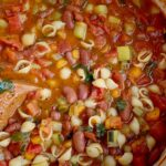 The Best Minestrone Soup   Soup Recipe   Healthy Recipe   This is honestly the best Minestrone Soup! A vegetable broth tomato base and then loaded with fresh vegetables, beans, and tender small shell pasta. It simmers in one pot on the stove top for a delicious and healthy dinner. #healthyrecipe #soup #minestronesoup #onepot #dinnerrecipeideas #easydinnerrecipe