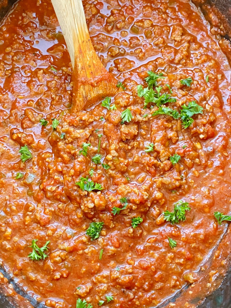 Come home to an Italian feast with this Slow Cooker ITALIAN SAUSAGE & BEEF SPAGHETTI SAUCE. Two meats simmer all day long in the crock pot for maximum flavor. Leftovers freeze really well for another pasta dinner night.