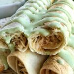 Baked Honey Lime Chicken Taquitos | A creamy, perfectly seasoned chicken mixture rolled up in a crispy flour tortilla and baked. No deep frying these taquitos! Baked Honey Lime Chicken Taquitos are a family favorite dinner. #dinnerrecipes #chickenrecipes #mexicanfood #dinner #taquitos #recipeoftheday