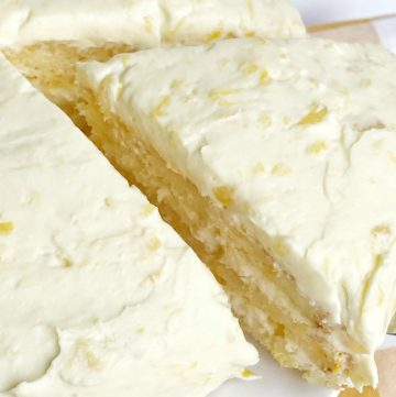 Orange pineapple layer is so easy to make. Uses a boxed cake mix plus a few other simple ingredients. The cake is so incredibly moist, light, and fresh tasting. The frosting is a simple pudding mix with crushed pineappleplus freshly whipped cream. This is the perfect dessert for Easter or summertime.