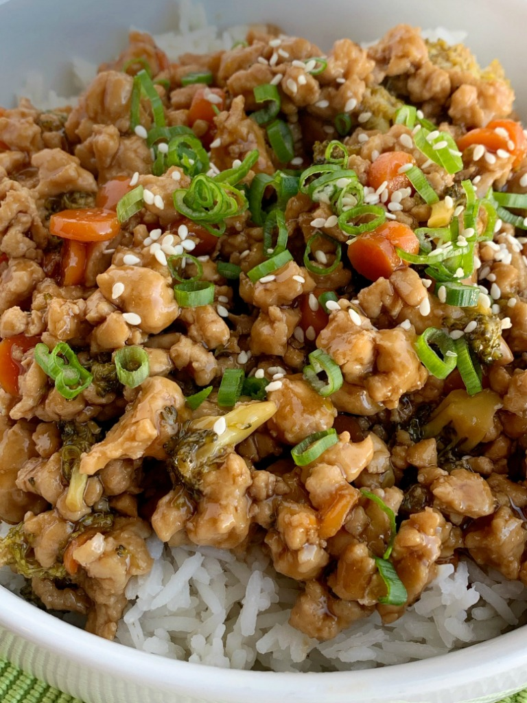 Teriyaki Chicken Rice Bowls   Teriyaki Chicken Recipe   Rice Bowls   Teriyaki chicken rice bowls take 30 minutes to make and are perfect for a busy weeknight dinner. Ground chicken, broccoli, and carrots simmer on the stove top in a delicious and simple teriyaki sauce. Serve over rice and garnish with green onions! #easydinner #dinnerrecipes #chickenrecipes #30minutemeals #teriyakichicken #ricebowls #recipeoftheday