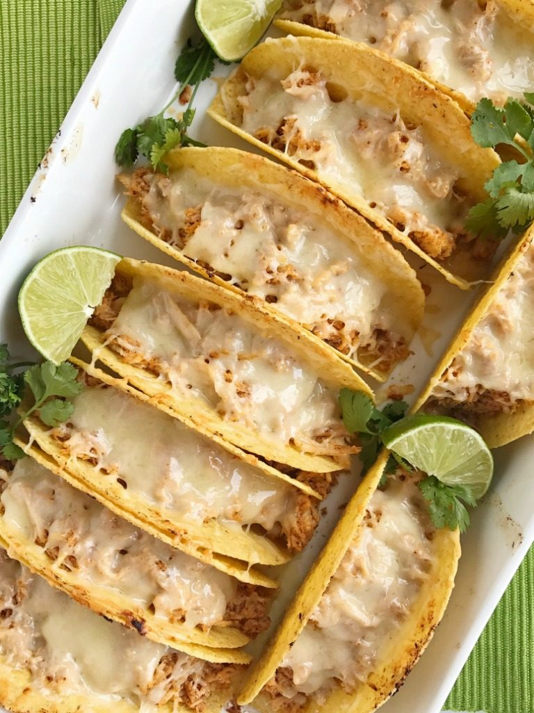 Switch up taco night with these oven baked honey lime chicken tacos. Shredded chicken seasoned with a honey lime mixture and baked in corn taco shells. Load up on the cheese for a crispy taco with gooey cheese. Serve with your favorite taco toppings. Dinner can be on the table in 30 minutes with this one and it's always a favorite.