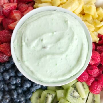 Pistachio yogurt fruit dip is the perfect summer treat for a hot day. Use up all the fresh summer fruits and make this easy 3 ingredient fruit dip. It's light, fluffy, creamy, and has added protein from the yogurt and a light pistachio flavor.