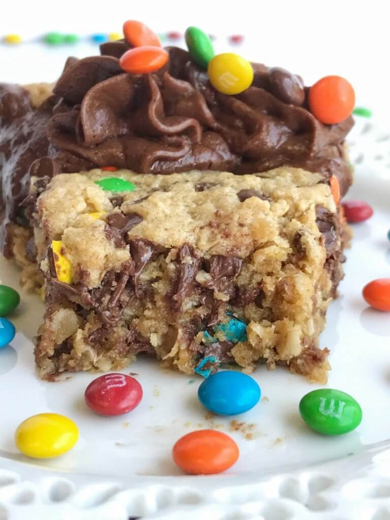 A giant monster cookie that's so thick, soft-baked, chewy, and loaded with all the monster cookie favorites. Oats, chocolate, peanut butter, and m&m's. This giant monster cookie makes for a great first day of school tradition too. Kids will love it as a fun after school snack to celebrate their first day.