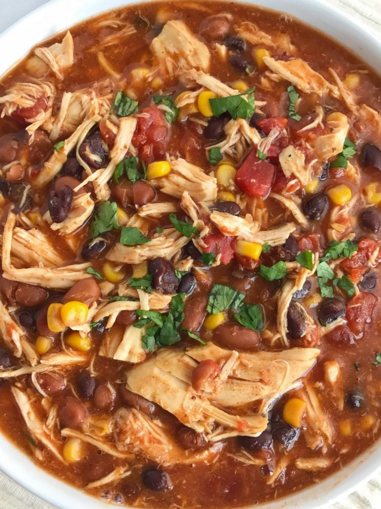 You'll love this taco ranch chicken chili that cooks in the slow cooker all day! Tender chicken loaded with vegetables, beans, and plenty of flavor. Only a few pantry staple ingredients is all you need for a satisfying dinner that is so comforting. Be sure and load it up with all your favorite toppings | Together as Family Blog | recipe | chili | taco soup | slow cooker | crock pot
