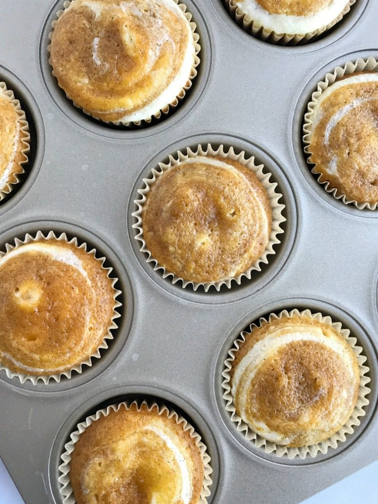 Pumpkin cheesecake muffins combine two of the best flavors for Fall; cheesecake and pumpkin! Moist and soft pumpkin muffins with a cheesecake swirl. These are so soft and tender and taste like pumpkin pie cheesecake. You must try this pumpkin recipe this Fall | www.togetherasfamily.com #pumpkinrecipes #pumpkinmuffins #pumpkinspice #cheesecakerecipes #pumpkincheesecakerecipes