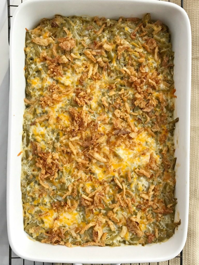Look no further for the best creamy cheesy green bean casserole! Only a few simple ingredients, canned green beans, and a few minutes prep is all you need for the best green bean casserole. No creamed soup and no mushrooms. This recipe is a must have side dish for Thanksgiving dinner | www.togetherasfamily.com #greenbeancasserole #sidedish #thanksgivingdinner #thanksgiving #casserole #greenbeans