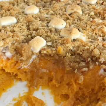 Creamy sweet potatoes topped with a loaded & crumbly topping! Loaded sweet potato casserole has a base of sweet potato topped with a crumble of marshmallows, pecans, and coconut! Everyone's favorite classic sweet potato casserole toppings all in one dish   www.togetherasfamily.com #thanksgivingrecipes #thanksgivingfood #sweetpotatocasserole #sweetpotatocasserolerecipe #casserolerecipes
