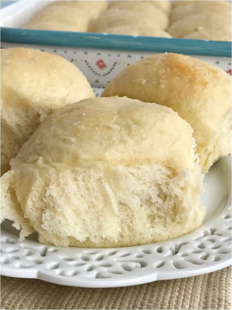 Soft, fluffy, & buttery rolls in just one hour! Yes it can be done and you won't believe how delicious and fail-proof these rolls are. These one hour rolls are perfect for Thanksgiving dinner or easy enough for a weeknight dinner | www.togetherasfamily.com #thanksgivingrecipes #thanksgivingfood #breadrecipes #rollrecipes #recipe