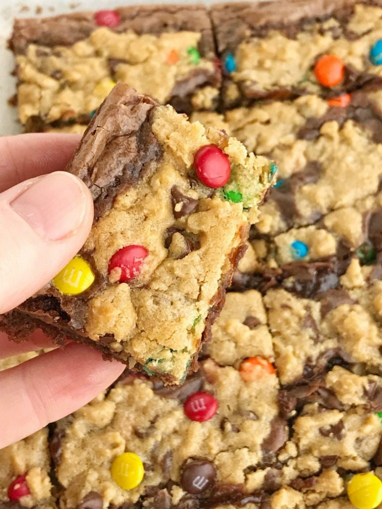 Monster Cookie Brownies | Monster Cookies | Brownies | Brookies | Monster cookie brownies start with a boxed brownie mix and then topped with a homemade monster cookie dough. Two desserts in one! Milk chocolate brownies and monster cookies loaded with peanut butter, oats, chocolate chips, and m&m's. #dessert #easydessertrecipes #brownies