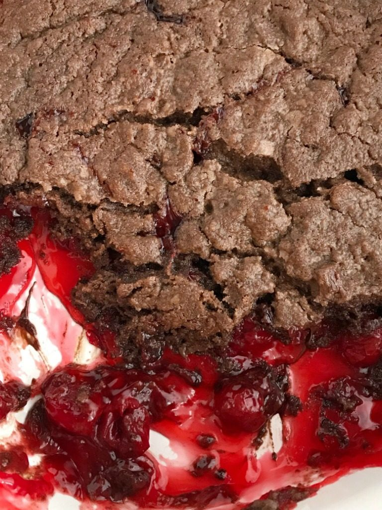Black Forest Chocolate Cobbler | Chocolate Cobbler | Black Forest Dessert | Desser Recipes | Chocolate cobbler gets a fun black forest twist with canned cherry pie filling. You only need 4 ingredients to make this easy black forest chocolate cobbler dessert. Serve with some whipped cream or a scoop of ice cream for an easy & simple dessert recipe that everyone will love. #dessert #chocolate #easydessertrecipes