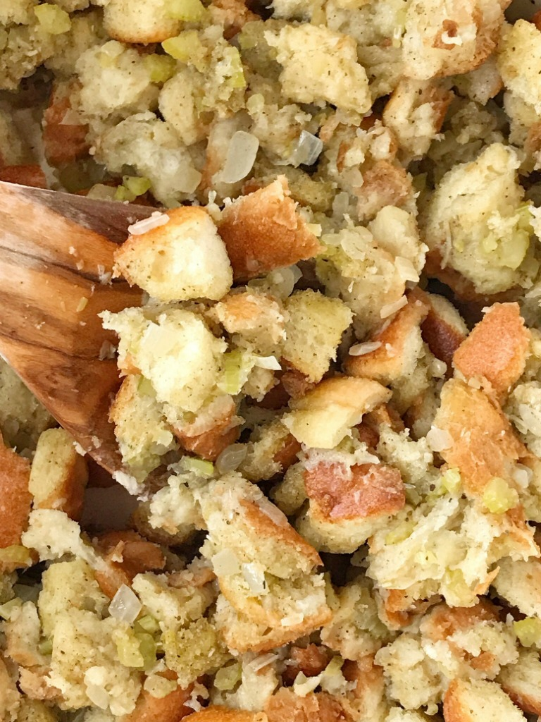 Stove Top Stuffing Recipe | Stuffing Recipe | Homemade Stuffing | Easy homemade stuffing made right on the stove top in just 30 minutes! Crusty bread chunks dried in the oven and then cooked with butter, seasonings, celery, and onion in a pot on the stove. This stove top stuffing will be a family favorite Thanksgiving recipe. #thanksgivingrecipe #stuffing #homemadestuffing #sideidsh #recipeoftheday