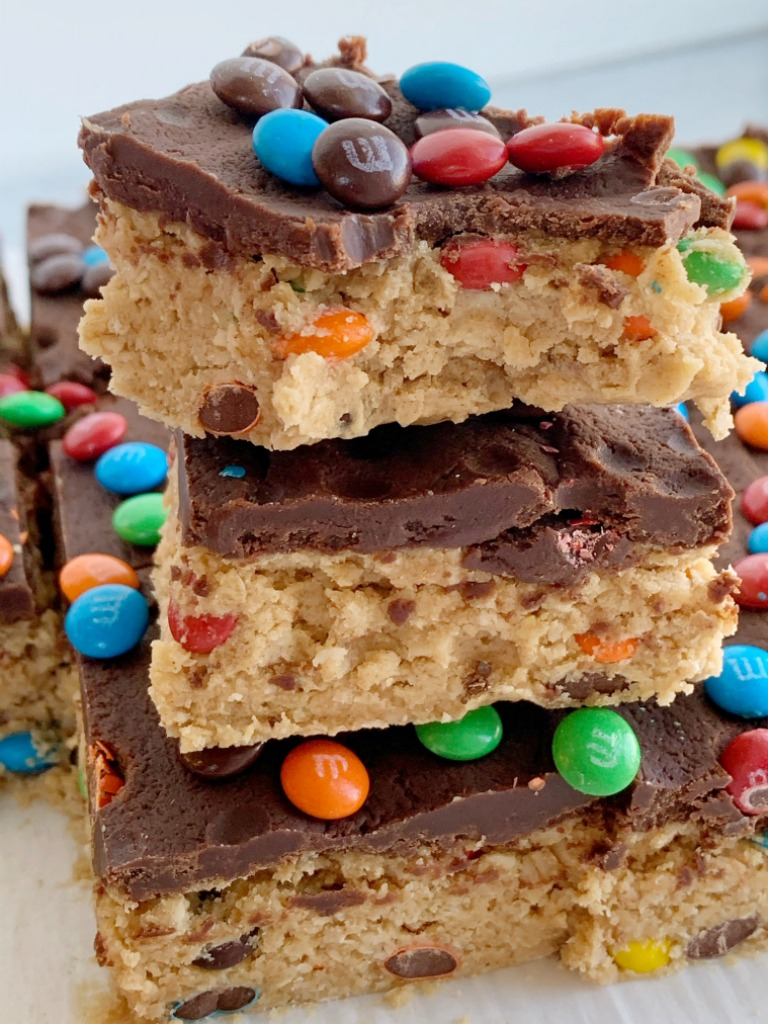 All your favorites about monster cookies but in no-bake, egg free monster cookie dough bars! Peanut butter, oats, chocolate, and m&m's. Everyone will love these easy and simple monster cookie dough bars.
