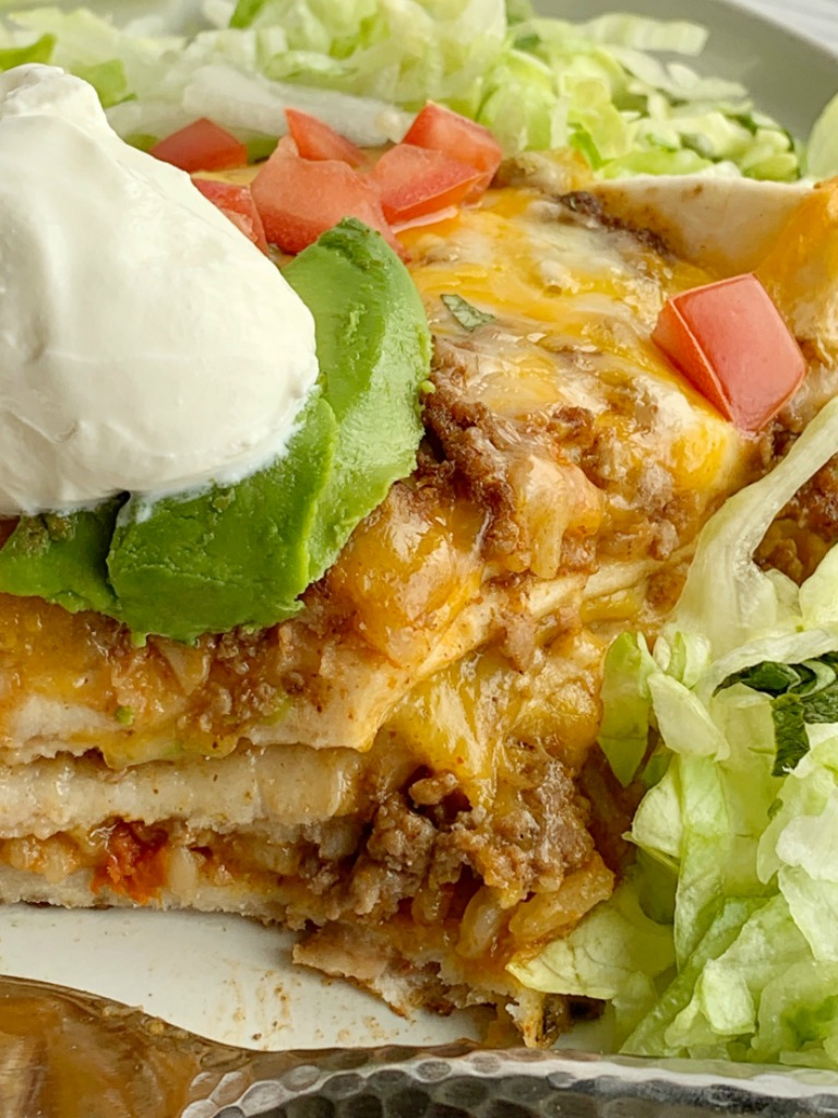 Burrito Lasagna | Lasagna Recipe | Casseroles | Burrito Lasagna is a tried & true family favorite! This ground beef burrito lasagna is simple to make with minimal ingredients. Layers of seasoned ground beef, Spanish rice, cheese, refried beans, and lots of cheese. #lasagna #dinnerrecipes #recipeoftheday #groundbeefrecipes