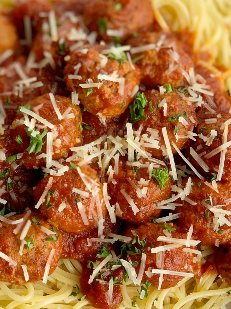 Easy Slow Cooker Spaghetti & Meatballs   Spaghetti Meatballs Recipe   Dinner Recipes   Classic spaghetti meatballs that happen to be so easy to make right in a slow cooker! Frozen meatballs, pasta sauce, stewed tomatoes, and spices simmer all day for an at home restaurant taste. #spaghetti #dinner #meatballs #italianfood #recipeoftheday #dinnerrecipes #easydinnerrecipes