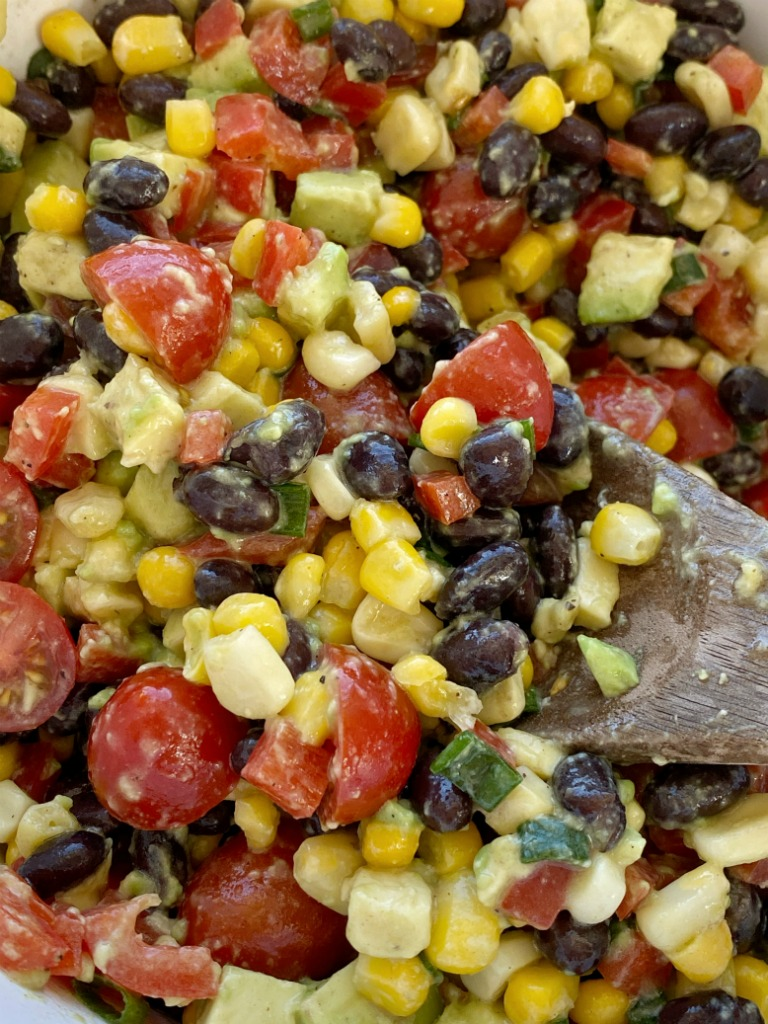 AVOCADO BLACK BEAN SALAD is a healthy and fresh salad with avocados, black beans, corn, red pepper, green onion, and tomatoes. The easy homemade honey lime vinaigrette is the best part!
