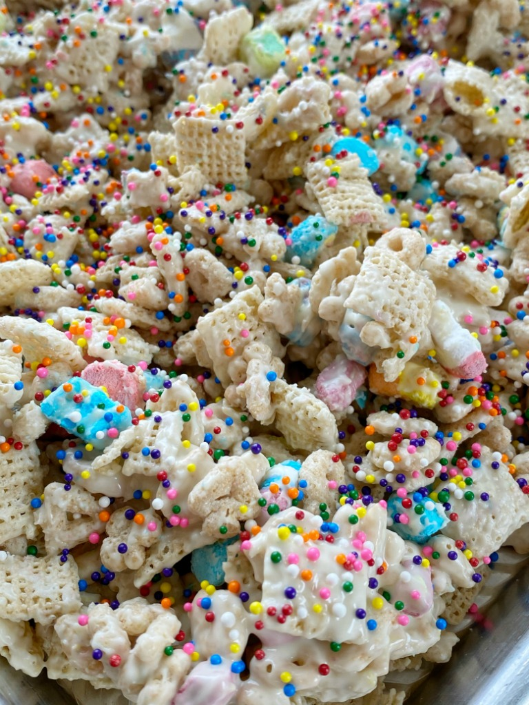 Lucky Charms Rainbow Snack Mix is a sweet and crunchy snack mix of lucky charms cereal, rice chex cereal, white chocolate chips, and rainbow sprinkles! Only 5 ingredients for this easy and delicious lucky charms snack mix.